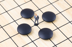 Businessman standing on the Go board game, Business st Royalty Free Stock Image