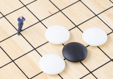 Businessman standing on the Go board game, Business st Royalty Free Stock Photos