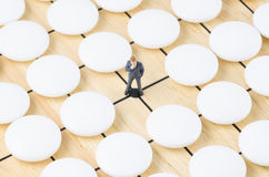 Businessman standing on the go table, stand out from t royalty free stock images