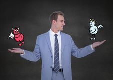 Businessman standing between the good and bad conscience Royalty Free Stock Photos