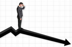 Businessman standing on a graph and looking down on the results Stock Photos