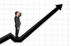 Businessman standing on a graph and looking up on the results. Successful businessman standing on a graph and looking up on the results -  on white Stock Image