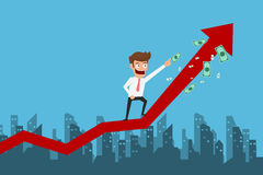 Businessman standing on growth graph and pointing to money. Success concept. Stock Photo