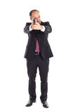 Businessman standing with a gun Stock Photo