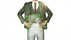Businessman standing with hands on hips with forest path overlay stock video footage