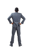 Businessman standing with hands on hips Royalty Free Stock Image