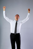 Businessman standing with hands raised up Royalty Free Stock Photo