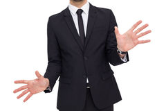 Businessman standing with hands spread out Stock Photo