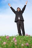 Businessman standing with hands up Stock Photo