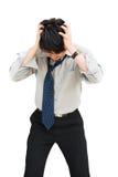Businessman standing head down stock photo