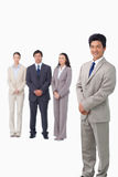 Businessman standing with his associates behind him Royalty Free Stock Image