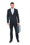 Businessman standing with his briefcase and documents Stock Photos