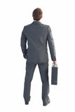 Businessman standing with his briefcase Royalty Free Stock Image