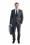 Businessman standing with his briefcase Stock Images