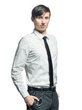 Businessman standing with his hands in the pockets. Stock Photos