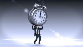 Businessman standing and holding giant clock stock video footage