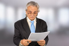 Businessman. Standing and holding paper Royalty Free Stock Photos