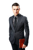 Businessman standing and holding tablet computer Royalty Free Stock Photo