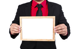 Businessman standing and holding white board Royalty Free Stock Photos