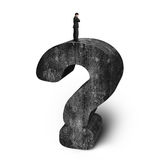 Businessman standing on huge 3D concrete question mark white bac Royalty Free Stock Photography