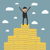 Businessman standing on the huge money staircase Royalty Free Stock Photos