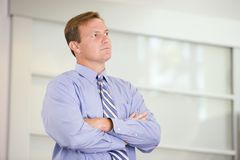Businessman standing indoors Stock Photos