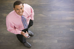 Businessman standing indoors Stock Photo