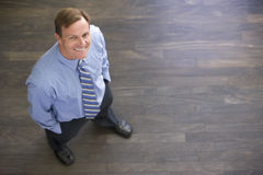 Businessman standing indoors smiling Stock Photos
