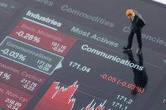 Businessman standing on the industry stock chart Stock Photos