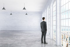 Businessman standing in interior Stock Images