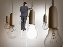 Businessman standing on ladder. Composite image of businessman standing on ladder writing Stock Photography