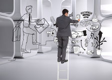 Businessman standing on ladder Royalty Free Stock Photos