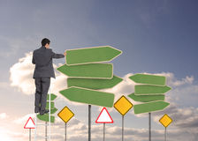 Businessman standing on ladder Royalty Free Stock Images