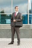 Businessman Standing with Laptop Bag Over Shoulder Royalty Free Stock Photography