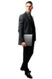 Businessman standing with laptop Stock Photos