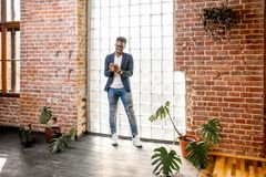 Businessman standing in the loft office royalty free stock images