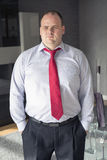 Businessman standing and looking thoughtful Royalty Free Stock Photos
