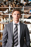 Businessman Standing In Manufacturing Warehouse Royalty Free Stock Photo