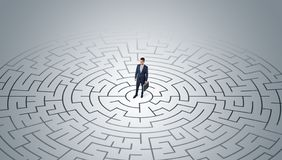 Businessman standing in a middle of a maze royalty free stock photography