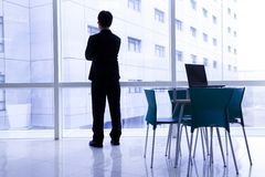 Businessman standing in the  modern office Royalty Free Stock Photos