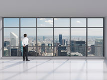 Businessman standing in modern office Royalty Free Stock Photos