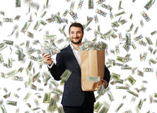 Businessman standing with money Royalty Free Stock Photography