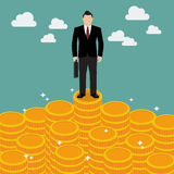 Businessman standing on money Royalty Free Stock Images