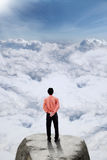 Businessman standing on the mountain peak Stock Photos