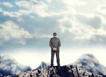 Businessman standing on mountain top Royalty Free Stock Photo