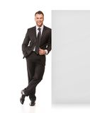 Businessman standing near board Stock Photos