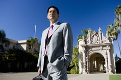 Businessman standing near historic building stock images