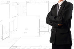 Businessman standing near a House blueprints Royalty Free Stock Photos
