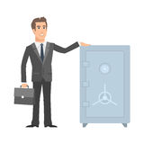 Businessman standing near safe and smiling Royalty Free Stock Image