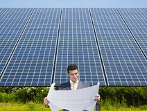 Businessman standing near solar panels Royalty Free Stock Photography